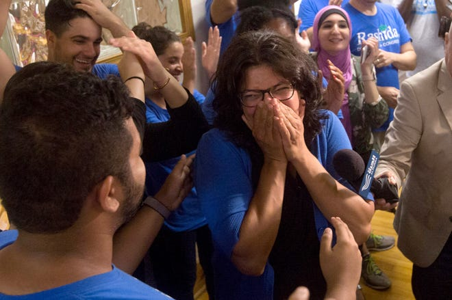 Rashida Tlaib celebrates after winning the democratic primary in Michigan's 13th District at one of Tlaib's field offices in northwest Detroit in the early morning of Aug. 8, 2018.