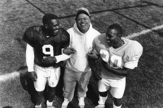 Lions coach Wayne Fontes with QB Rodney Peete and Barry Sanders in 1990.