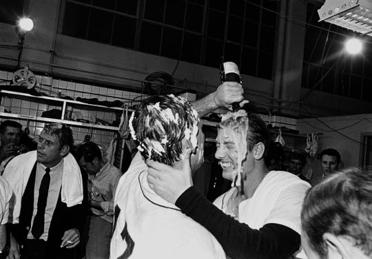 Detroit Tigers pitcher Denny McLain, his head covered in shaving cream, pours a bottle of champagne over the head of teammate Al Kaline as they celebrate their American League pennant victory in the dressing room in Detroit on Sept. 17, 1968.