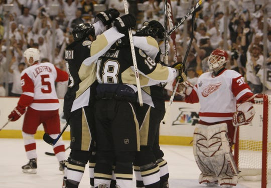 Pittsburgh celebrates its first goal of Game 3 of the the Stanley Cup final against Red Wings goalie Chris Osgood in Pittsburgh on Wednesday, May 28, 2008.