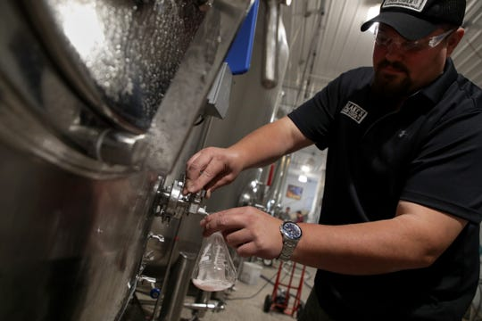Brewmaster Matt Wiles takes a sample of Rose hard cider at Blake's Orchard in Armada on Wednesday, September 5, 2018.