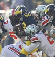 Michigan QB Devin Gardner is sacked late in the second quarter of their football game against Ohio State in Ann Arbor on Saturday, Nov. 30, 2013.