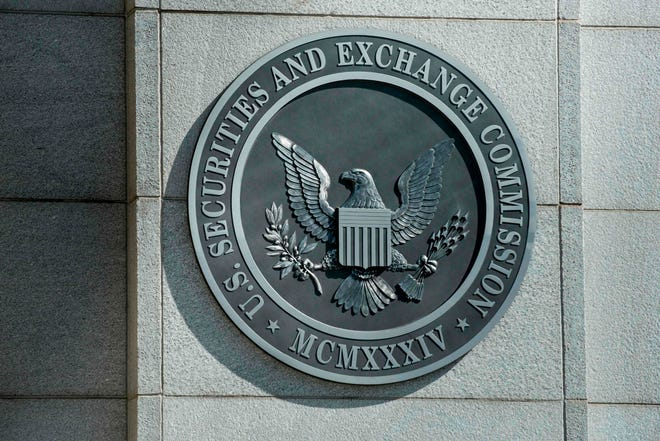 SEC charged two Michigan men in Nonko Trading scheme. File photo shows a view of the Securities and Exchange Commission headquarters in Washington, DC.