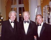 From left: Jay Van Andel, President Ford  and Rich DeVos.