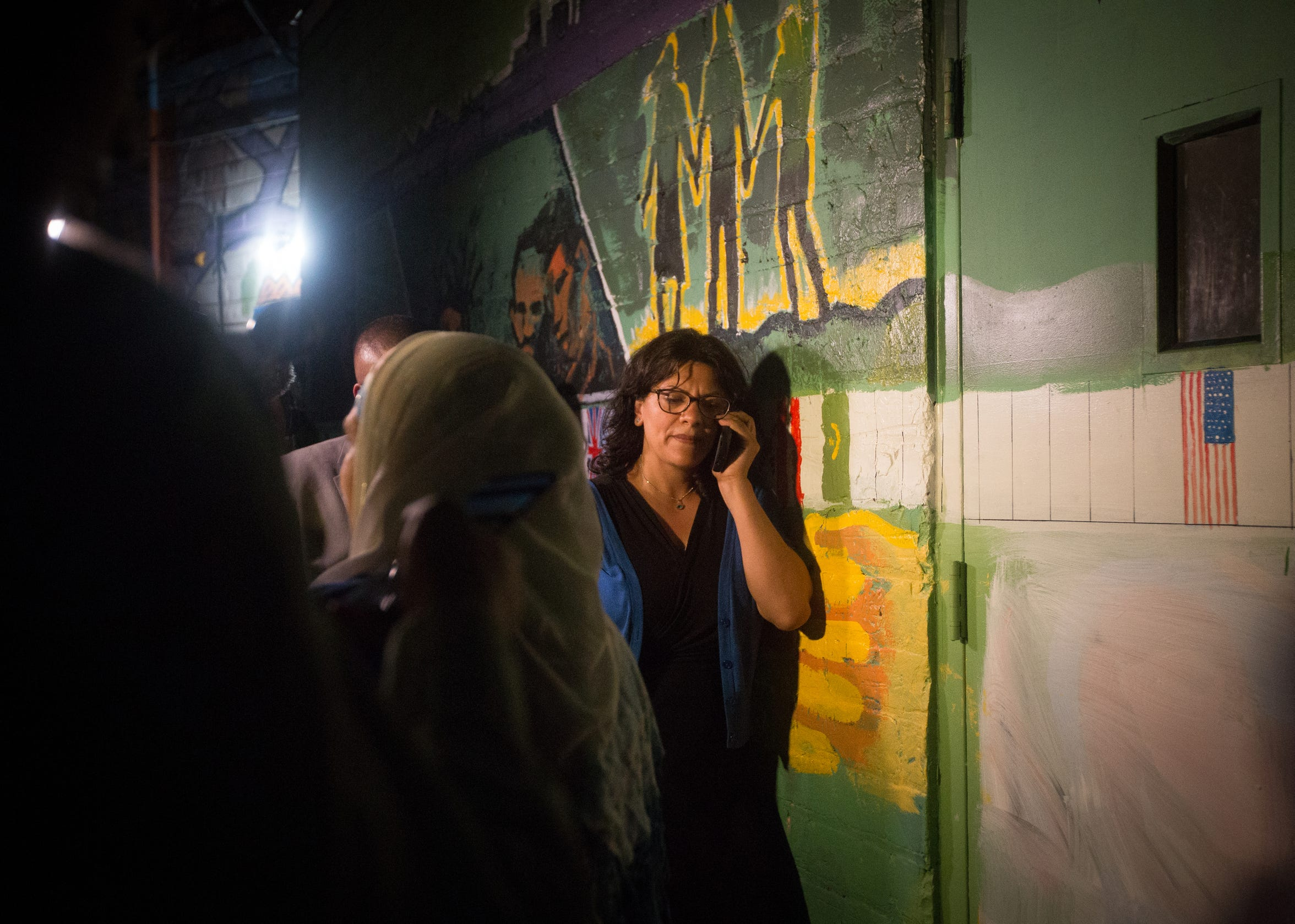 Rashida Tlaib attempts to find out the status of absentee ballots after the Associated Press called Tlaib's race in her favor at Tlaib's election night party in northwest Detroit on Aug. 7, 2018.