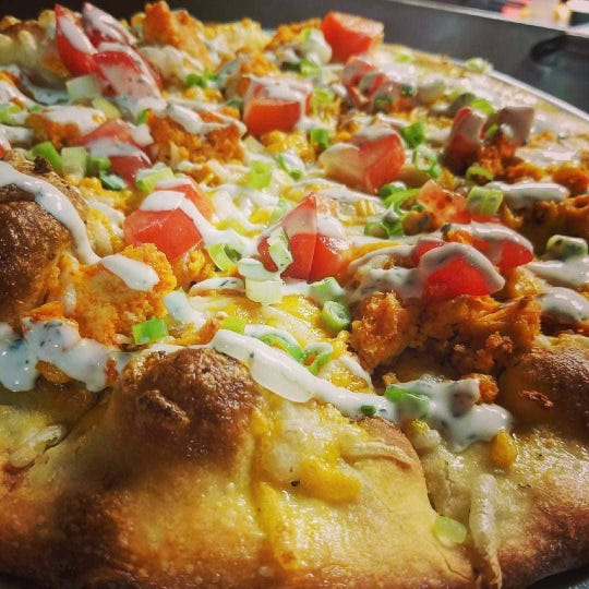 Brick Road Pizza Co. in Grand Rapids has an extensive pizza menumade with locally sourcedingredients and vegan options that reviewers love.