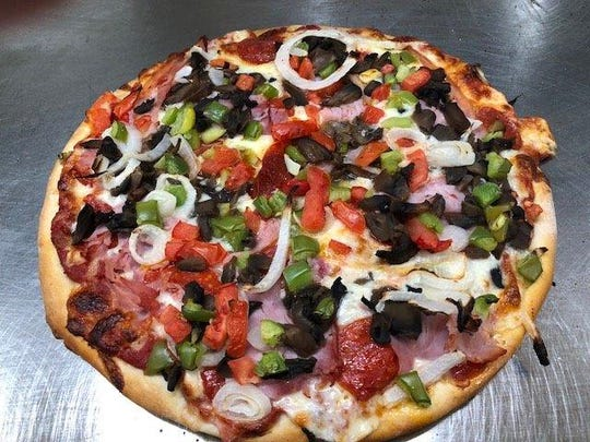 Deluca's Restaurant in Lansing has authentic, fresh pizza that isn't greasy and is loaded with toppings.