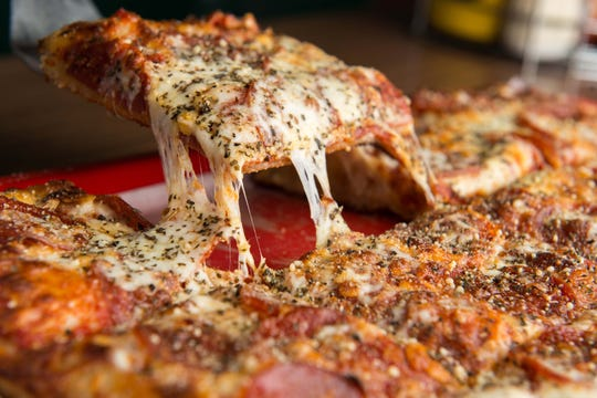 """Crunchy's in East Lansing has the interior of a """"college dive"""" with great pizza, onion rings and beer."""