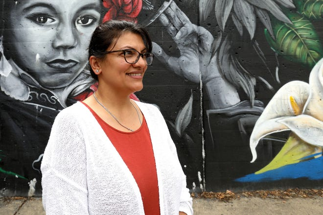 Rashida Tlaib in front of one of the murals in southwest Detroit on August 21, 2018.