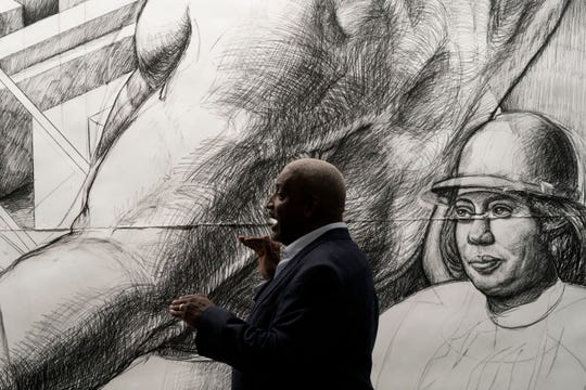 """In 2016, artist Hubert Massey stands in front of the 30-foot-by-30-foot charcoal preparatory drawing -- the """"cartoon"""" -- for the artist's massive fresco-style mural that is being unveiled on Sept. 7, 2018 at Cobo Center."""