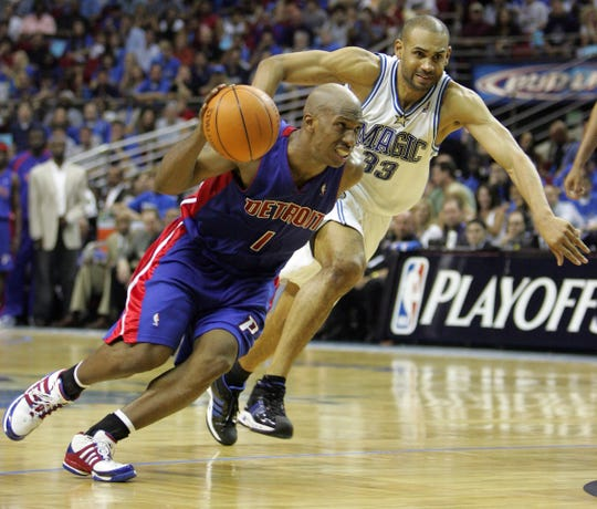 Pistons guard Chauncey Billups drives past against Magic forward Grant Hill during the second half of Game 4 of the Eastern Conference quarterfinals in Orlando on Saturday, April 28, 2007.