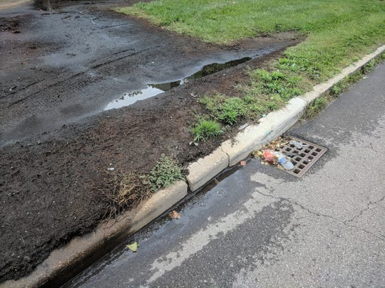 The oozing contamination from the Intrastate Distributors Inc. factory site -- makers of Towne Club pop -- reaches an adjacent storm drain on Mt. Elliott St.