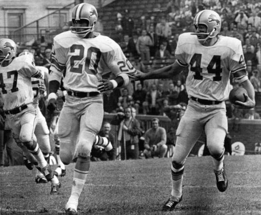After intercepting a second period Chicago Bears pass in Chicago Sunday, Detroit Lions cornerback Dick LeBeau (44) tugs on sleeve of teammate Lem Barney (20) to indicate desired path for his 26-yard runback in 1970. At left is Lions safety Wayne Rasmussen (47). Lions won 16-10.