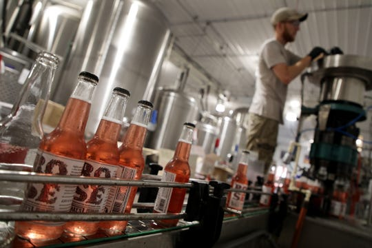 Bottles of Rose from Blake's Hard Cider Co. are packaged at Blake's Orchard in Armada in 2018.