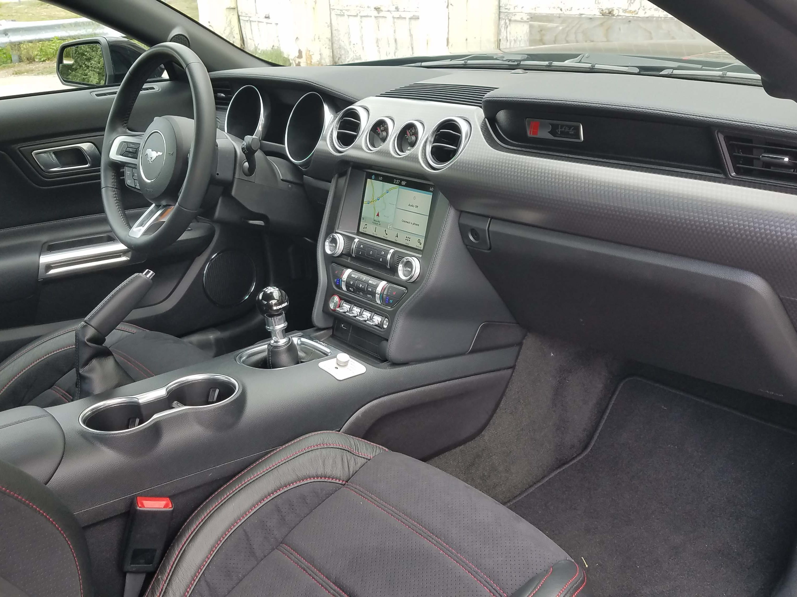 The interior of the 2018 Roush Jackhammer Mustang Jackhammer dash mediallion and serial number, sill badging, and the must-have active exhaust option with multiple exhaust modes.