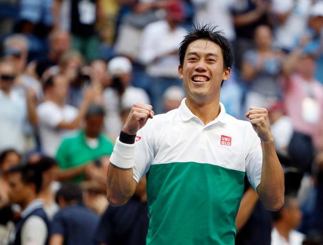 Kei Nishikori celebrates after defeating Marin Cilic in the U.S. Open quarterfinals on Wednesday.