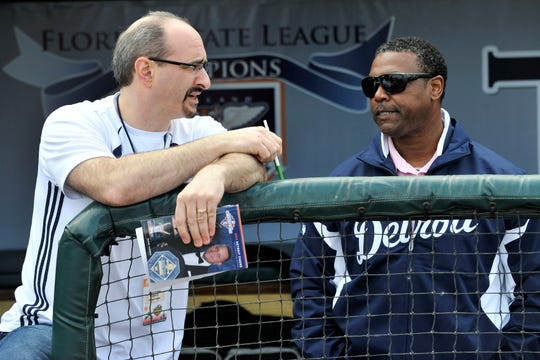 Tigers television broadcasters Mario Impemba, left, and Rod Allen talk in the dugout during spring training in 2013.