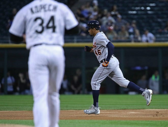 Tigers' Jeimer Candelario runs the bases after hitting a leadoff home run in the first inning off White Sox starter Michael Kopech.