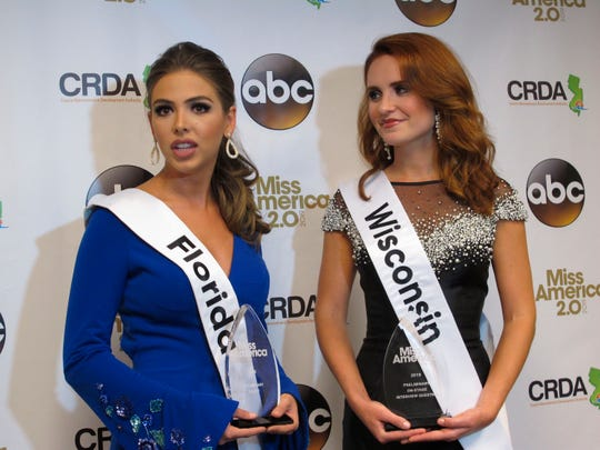 Miss Florida, Taylor Tyson, left, and Miss Wisconsin, Tianna Vanderhei, talk to the media after the first night of preliminary competition at the Miss America competition in Atlantic City, N.J., Wednesday, Sept. 5, 2018. Tyson won the talent competition and Vanderhei won the onstage interview competition.
