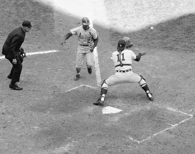 With the Cardinals up 3-2 in the fifth, Lou Brock (20) attempted to score on a single and was gunned down by Willie Horton at the plate, where Bill Freeham applies the tag that turned the World Series in the Tigers favor.