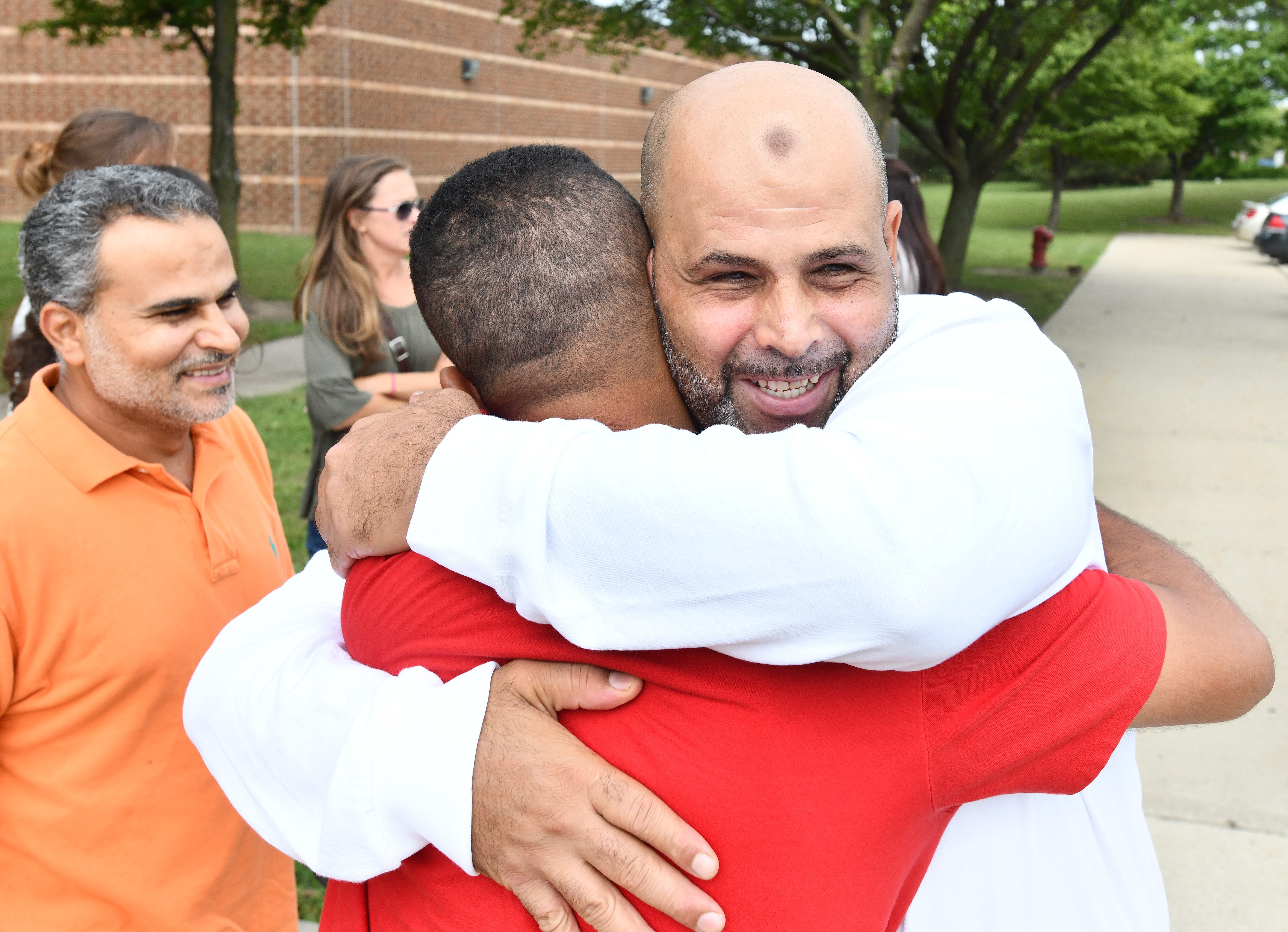 Mubarez Ahmed, hugging friends and relatives and persons involved in his release, as he leaves the William Dickerson Detention Facility after serving 16 years for a murder he possibly didn't commit, in Detroit, Michigan on September 6, 2018.