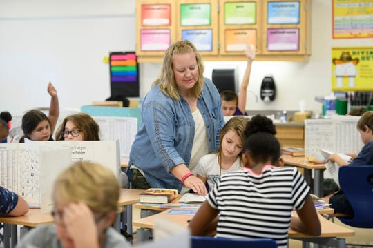 Stephanie Janigian teaches math to fifth-graders at Madison Heights Elementary. Math teachers are in high demand in Michigan.
