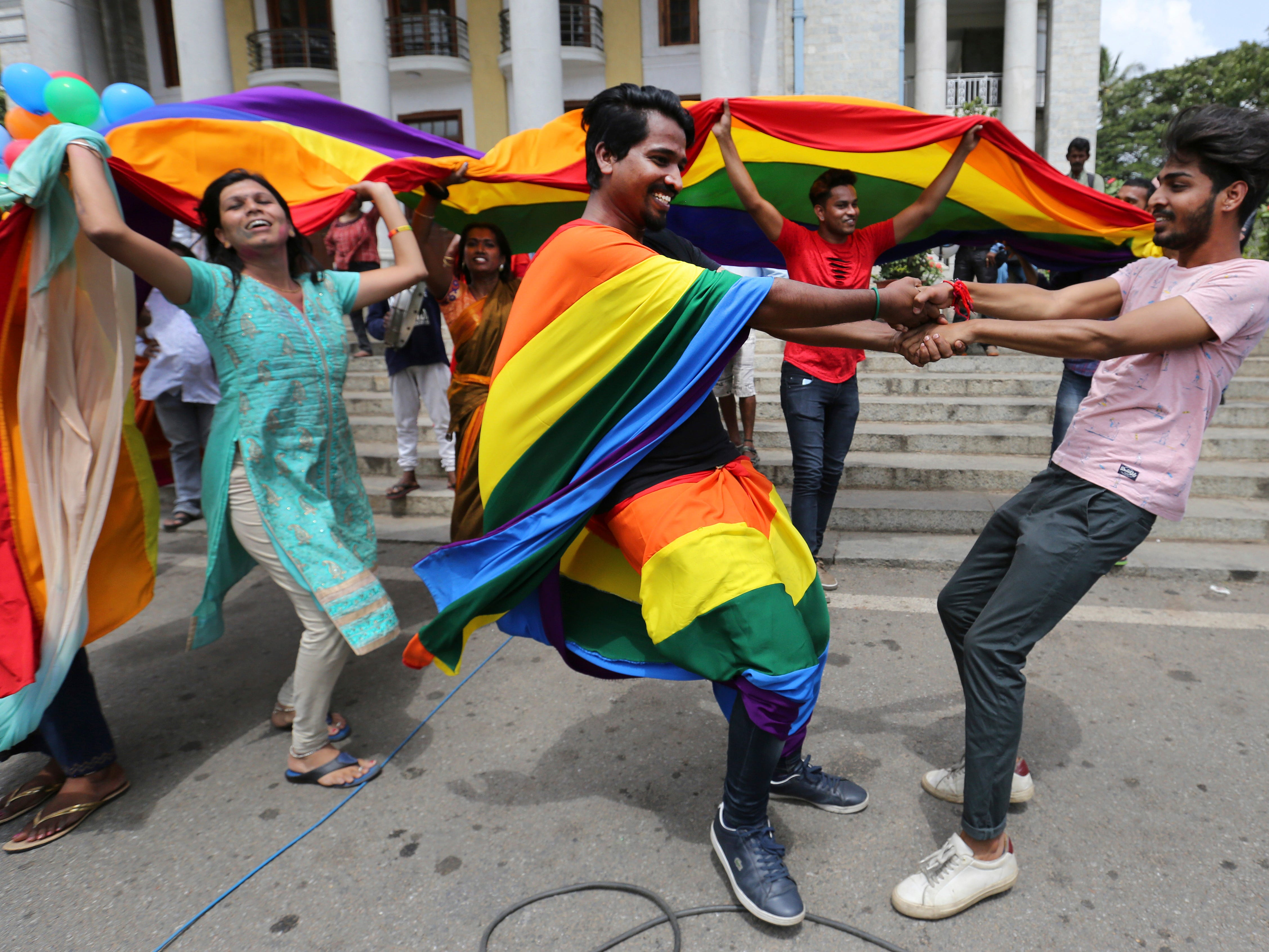 Members of the LGBT celebrate Thursday in Bangalore, India, after the country's top court struck down a colonial-era law that made homosexual acts punishable by up to 10 years in prison. The court gave its ruling on a petition filed by five people who challenged the law, saying they are living in fear of being harassed and prosecuted by police.