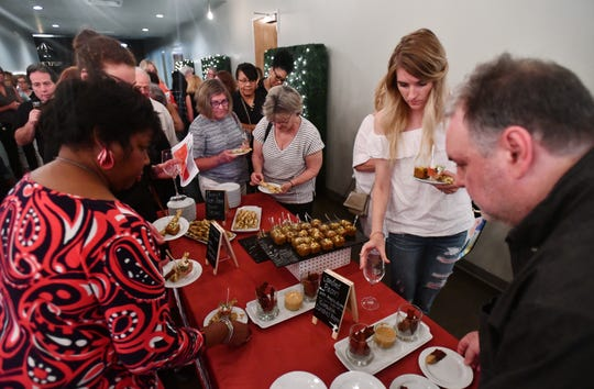 Guests enjoy appetizers during a break between speakers at a June Dish & Design event. The series returns Sept. 26.