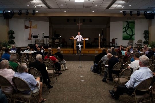 Steve Kaiser, EPA Regional Counsel, speaks during a public hearing on the McLouth Steel settlement agreement. About 120 residents who live in communities near the site attended the meeting at St. Paul Lutheran Church on Edsel Street in Trenton.