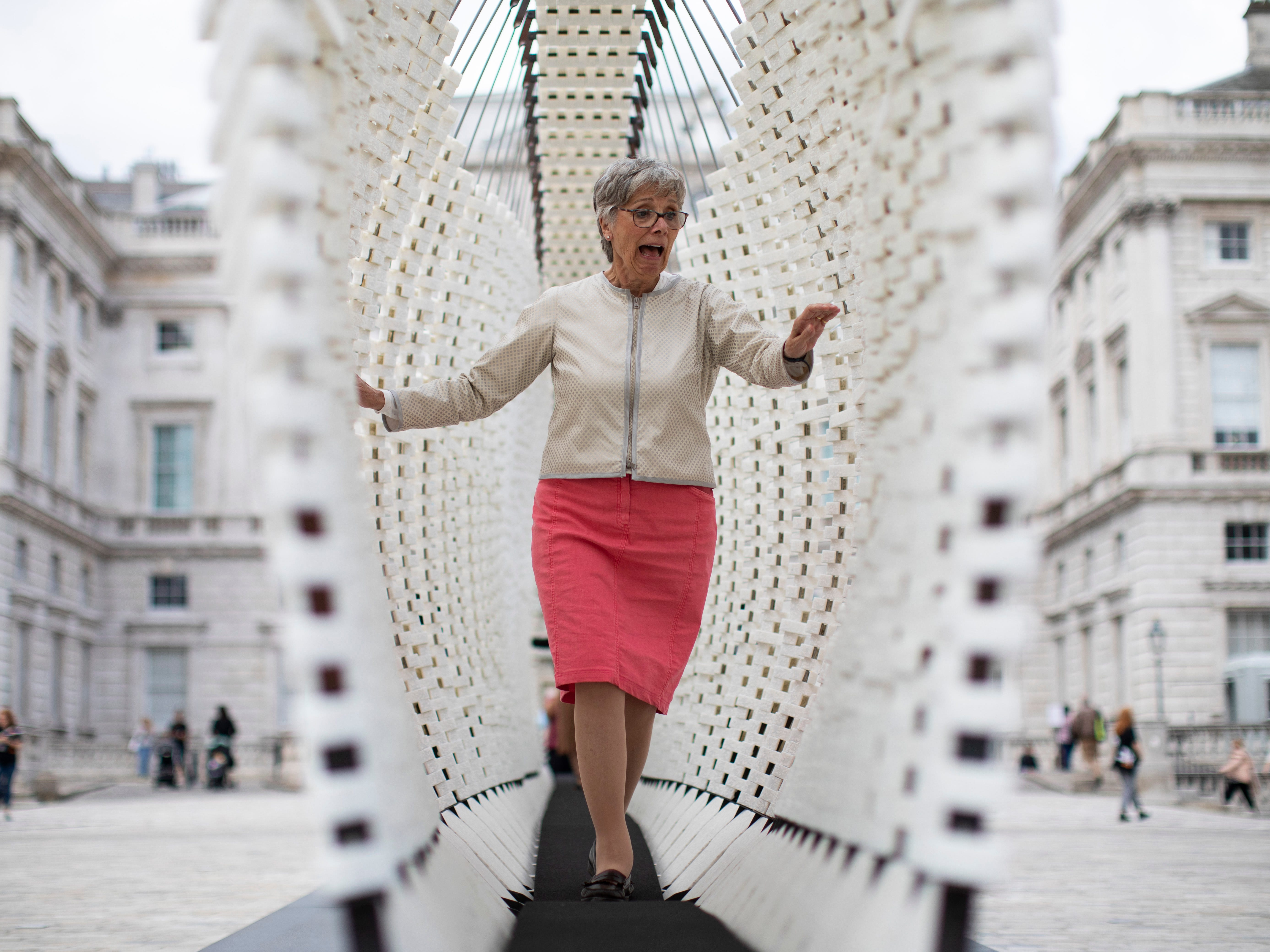"A member of the public walks through a piece of installation art entitled ""Disobedience"" by Greek artist Nassia Inglessis during the ""London Design Biennale"" at Somerset House on Sept. 6, 2018 in London, England. The exhibition includes a wide variety of interactive works from around the world  that play with the theme of emotion, and aims to highlight how design can impact on peoples everyday lives."