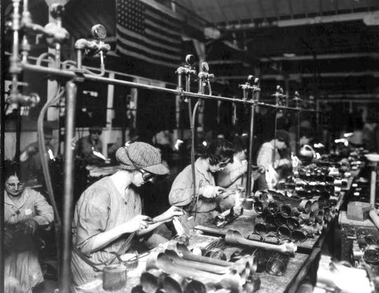 "During both world wars, while most of the men fought in Europe, women ""manned"" the munitions factories and converted auto plants, producing fighting equipment. By October of 1943, there were 140,000 women in the defense industry. Willow Run in Ypsilanti hired 117 in one week."