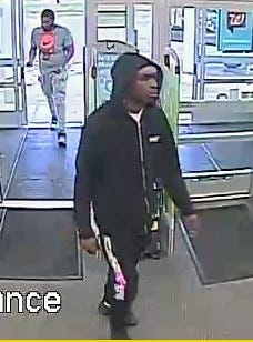 The Elmira Police Department released surveillance photos of these two suspects in a credit card cloning scam.