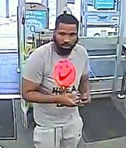 This is a closeup of one of the suspects in an Elmira credit card cloning scam.