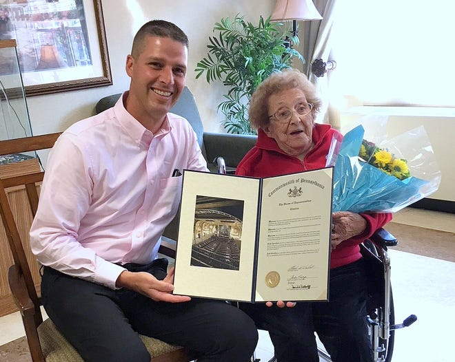 Pennsylvania State Rep. Clint Owlett presents Eleanor Lychalk, of Galeton, a citation marking her 100th birthday.