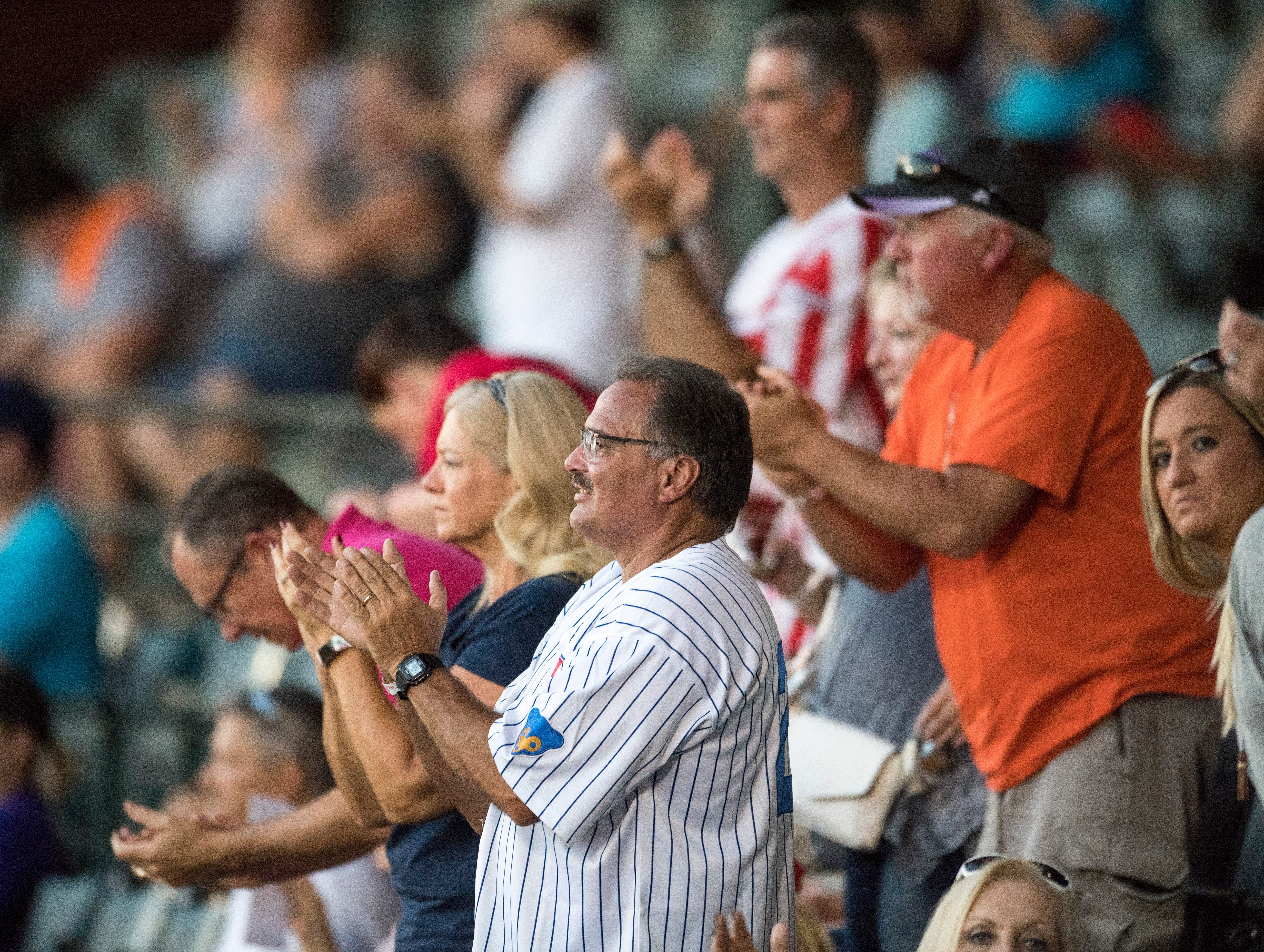 The fans stand and cheer on the Evansville Otters during game two of the Frontier League Division Series at Bosse Field against the Washington Wild Things Wednesday, September 5, 2018.