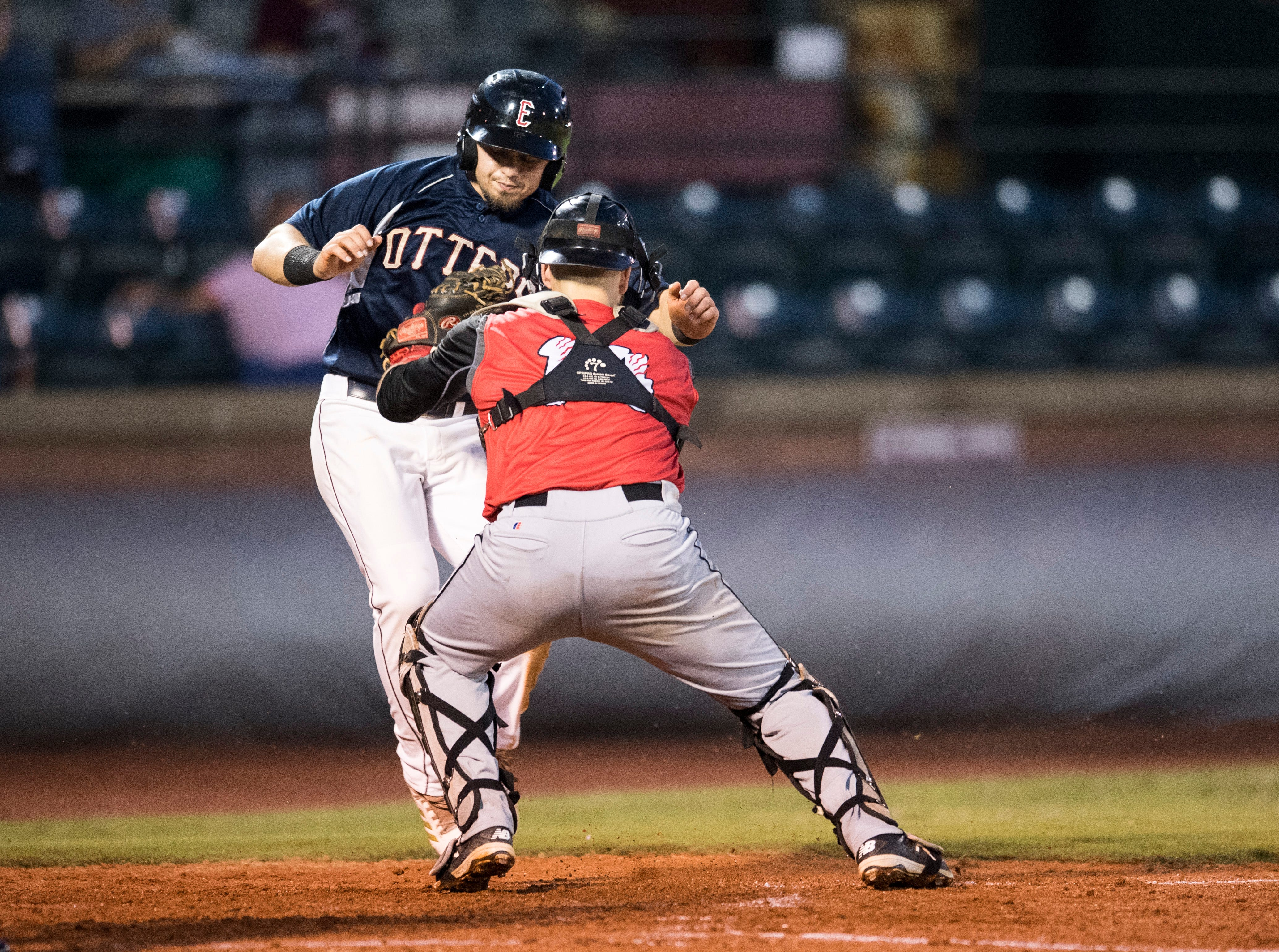 Evansville's Ryan Long (7) attempts to not get tagged at home during game two of the Frontier League Division Series at Bosse Field against the Washington Wild Things Wednesday, September 5, 2018.