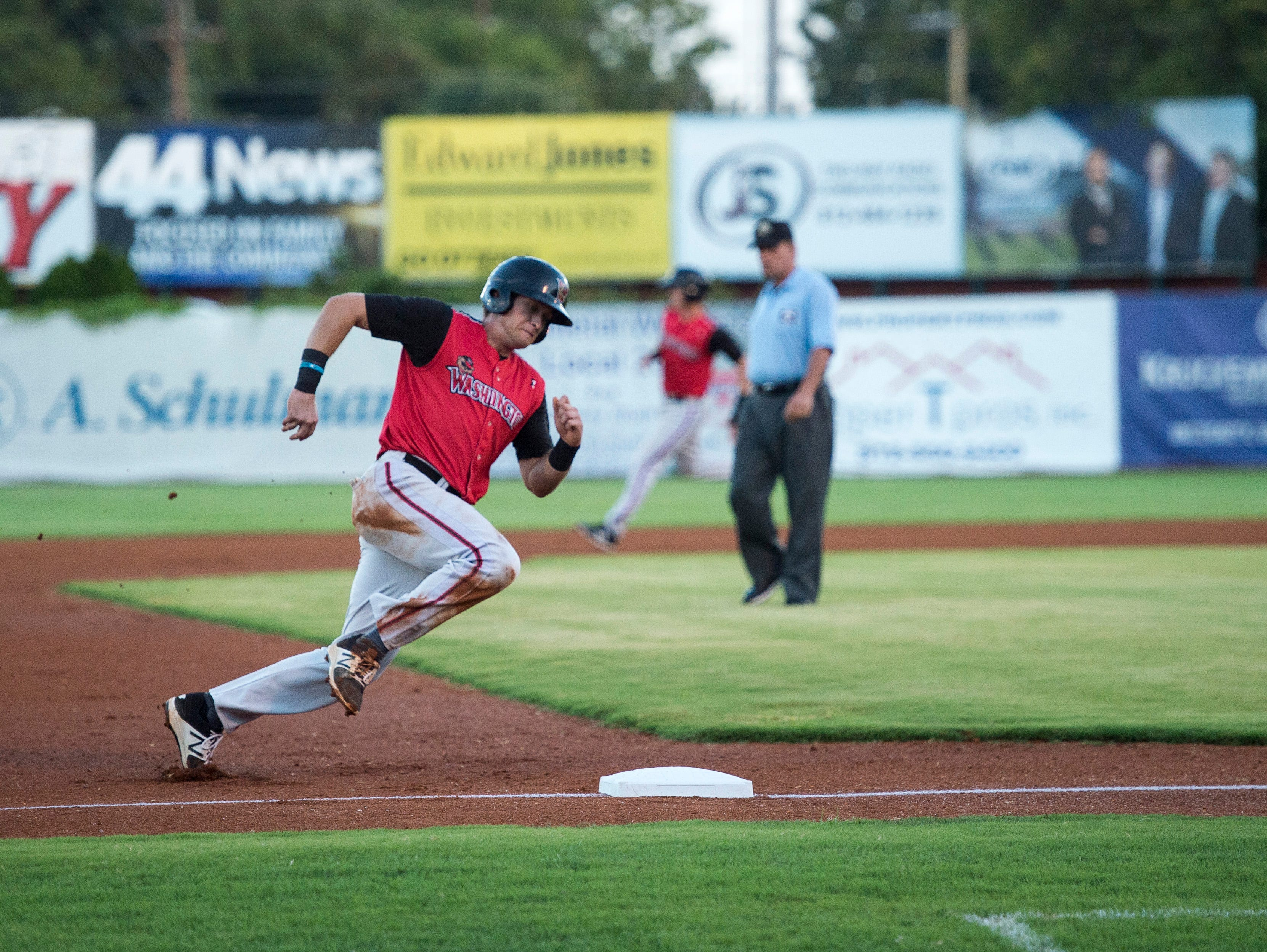 Washington's Roman Collins (19) rounds third base during game two of the Frontier League Division Series at Bosse Field against the Evansville Otters Wednesday, September 5, 2018.