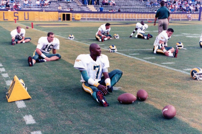 Quarterback Anthoney Hill (7) and his CSU teammates stretch before beating LSU 17-14 on Sept. 26, 1992, at Tiger Stadium. The win is the one and only victory ever by CSU over an SEC football team.