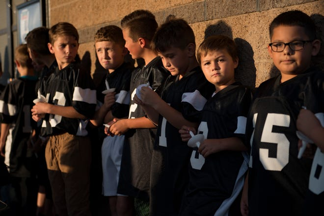 Wolf Pack teammates of Brycen Zerby, 8, attend a vigil for their friend at Eastman Park in Windsor on Wednesday, September 5, 2018. Zerby was killed Monday after being struck by a float during the Windsor Harvest Festival Parade.