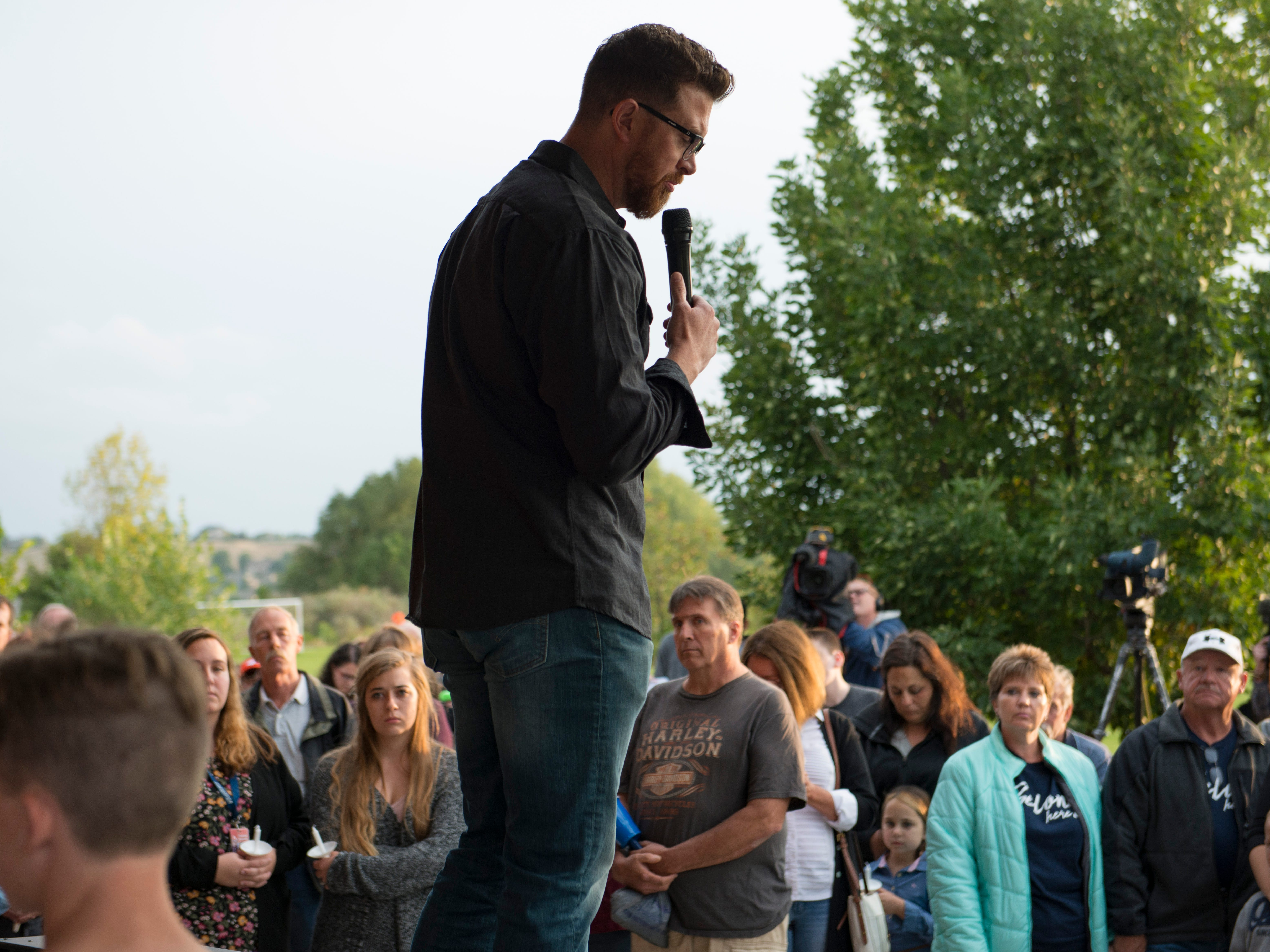 Pastor Eric Ebbinghaus of Generations Church says a few words about  Brycen Zerby, 8, at Eastman Park in Windsor on Wednesday, September 5, 2018. Zerby was killed Monday after being struck by a float during the Windsor Harvest Festival Parade.