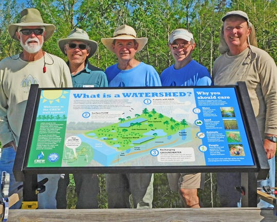 Dick  Brewer, on right with other CREW volunteers, spends most of his time on the trails at CREW's Bird Rookery Swamp, though he forays into the Cypress Dome trails as well. He volunteers as a citizen scientist, performing animal surveys along his route.