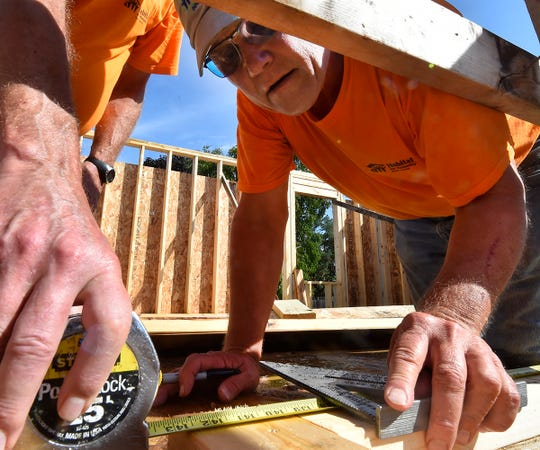 Site manager Chuck Stone of Sturgeon Bay helps lay out a wall at the Door County Habitat for Humanity home build in Sturgeon Bay on Tuesday, Sept. 4, 2018. Tina M. Gohr/USA TODAY NETWORK-Wisconsin
