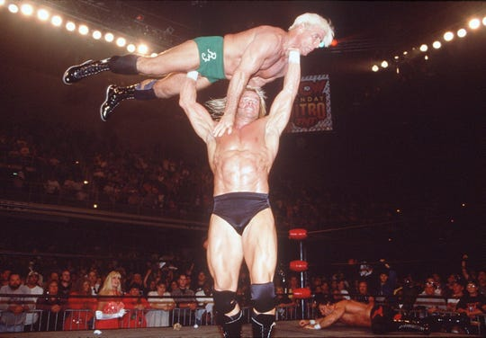 Lex Luger, bottom,  became one of wrestling's biggest superstars after his football career.