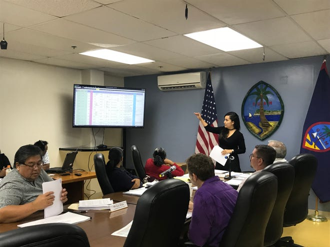 Chamorro Land Trust Commission board chairwoman Pika Fejeran reviews the 1995 applicant list at a meeting on Sept. 6, 2018.