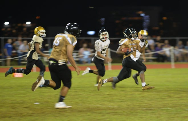 John F. Kennedy Islanders running back Deante Delgado, 13, goes for big yards against the Tiyan Titans during their game Sept. 1 at Ramsey Field. JFK won 28-0 and will face the Father Duenas Friars in the PDN Game of the Week at 7 p.m. Sept. 8 at JFK.