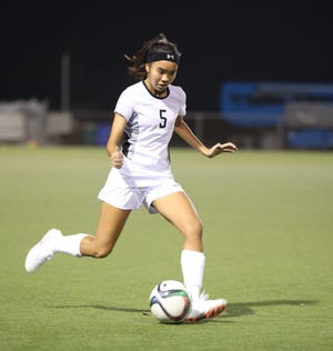 Celine Doronila of the Guam Masakåda prepares to send the ball forward during a recent training match at the Guam Football Association National Training Center in this file photo. The team played to a single goal loss to Mongolia in Wednesday's EAFF E-1 Football Championship Round 1 women's competition in Ulaanbaatar, Mongolia.