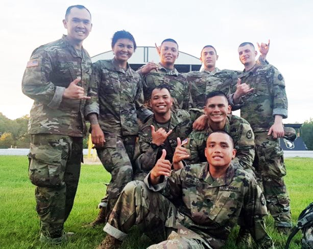 Guam Army National Guard soldiers, from left, front row: 2nd Lt. Kristian Dizon; 2nd Lt. Estella Aguon; Pfc. Josh Mantanona; Pfc. Jeff Garcia; and Spc. Christopher Quinlan; kneeling, second row, Spc. Jesse Crisostomo and Sgt. Gerard Ogo, seated in front, Spc. Lief Galvez