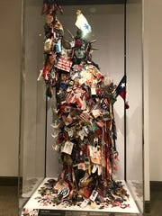 Items collected around a small statue of liberty in lower Manhattan after the terrorist attacks of Sept. 11, 2001, in New York City.