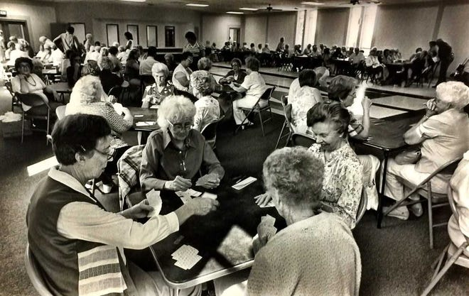 Henderson County Senior Citizens Inc. first used The Gathering Place at 1817 N. Elm St. on  Aug. 19, 1985, at which time about 135 people used the facility.  Depicted playing rook are Catherine Watkins, Elizabeth Reeder, Matilda Gaines and Jane Oglesby. The organization is holding its annual Senior Games this week and also noting its 50th anniversary. Gleaner file photo by Mike Lawrence.