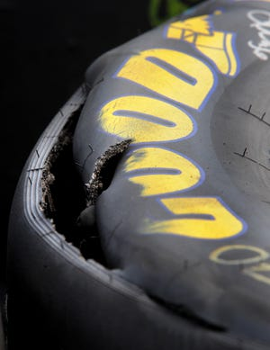 Goodyear tires sit shredded and flat by the Goodyear garage area during the Allstate 400 at the Brickyard at the Indianapolis Motor Speedway Sunday July 27, 2008. (Matt Kryger / The Indianapolis Star)